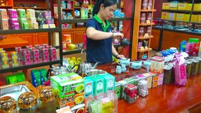 Tea shop in Chiang Rai, Thailand. CHIANG RAI, THAILAND - MAY 10, 2019: Suwirun tea shop attracts visitors and tourists with free oolong tea making demostration stock video