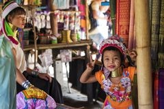 CHIANG RAI, THAILAND - NOVEMBER 4 2017: Unidentified Long Neck Karen hill tribe girl smiling. And showing victory sign stock photography