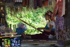 CHIANG RAI, THAILAND - NOVEMBER 4 2017: Unidentified Long Neck Karen woman making folk art goods stock images