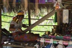 CHIANG RAI, THAILAND - NOVEMBER 4 2017: Unidentified Long Neck Karen woman making folk art goods stock photos