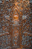Chiang Rai, Thailand - October 1, 2016: A scene of Buddhism, sculptured wood  in Wat Phra That Doi Ngam Muang Royalty Free Stock Image