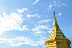 Chiang Rai, Thailand - October 1, 2016: Wat Phra That Doi Chom Thong, Chedi or Golden Pagoda of Stupa with blue sky. Stock Image