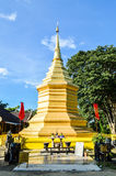 Chiang Rai, Thailand - October 1, 2016: Wat Phra That Doi Chom Thong, Chedi or Golden Pagoda of Stupa with blue sky. Stock Images