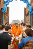 CHIANGMAI - APRIL 13, 2008: Songkran Festival, People put food offerings in a Buddhist monk's alms bowl for virtue at Tha Phae gat Stock Image