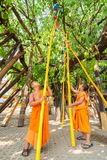 CHIANGMAI, THAILAND-APRIL 15 : Worship in Songkran Festival , A. Little monk crutches PHO tree instead for crutches long life  in the temple Wat Royalty Free Stock Photography