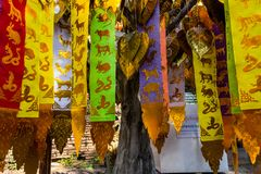 The beliefs. ChiangMai, Thailand. December, 12-2017: The astrologious papers hanged up in front of worship's house for tourist to make offerings to the spirits Royalty Free Stock Images