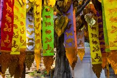 The beliefs. ChiangMai, Thailand. December, 12-2017: The astrologious papers hanged up in front of worship's house for tourist to make offerings to the spirits Royalty Free Stock Image