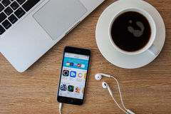 CHIANGMAI,THAILAND - FEBRUARY 5, 2015: Brand new Apple iPhone 5S with iTunes store application on the screen lying on a desk. royalty free stock photos