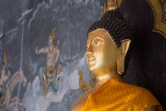 Details of golden buddha statue with tales of the lord Buddha`s Royalty Free Stock Photo