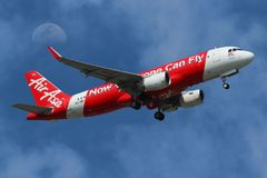Airplane of hai AirAsia Airbus A320-200 Taking Off with The Moon stock photos