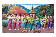 CHIANGMAI, THAILAND - SEPTEMBER 9, 2016: Steengravure van het traditionele Thaise landelijke cultuurleven in het verleden op temp stock afbeelding