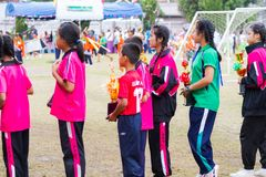 CHIANGRAI, THAILAND - DECEMBER 29: unidentified sport children h. Olding trophy cup in line on December 29, 2017 in Chiangrai, Thailand stock images