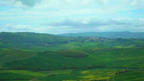 Chianti hills in Tuscany. Chianti hills with cypress trees, in Tuscany. Wind and clouds draw clear shadows on the ground.n stock footage
