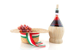 Chianti from Italy. Basket bottle with Chianti grapes and hat from Italy over white royalty free stock images