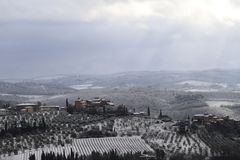 The Chianti landscape in the Tuscan hills after a winter snowfall royalty free stock images