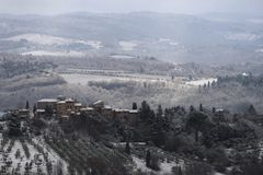 The Chianti landscape in the Tuscan hills after a winter snowfall. Chianti, Tuscany, Italy royalty free stock photo