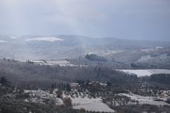 The Chianti landscape in the Tuscan hills after a winter snowfall stock image