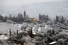 The Chianti landscape in the Tuscan hills after a winter snowfall stock photo