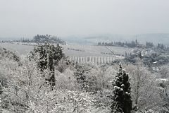 The Chianti landscape in the Tuscan hills after a winter snowfall stock photos