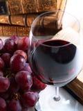 Chianti reserve red wine, glass, grapes. Chianti reserve wine, glass, grapes and old books Royalty Free Stock Photo