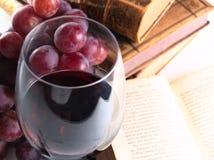 Chianti reserve red wine, glass, grapes. Chianti reserve wine, glass, grapes and old books Royalty Free Stock Image