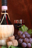 Chianti wine bottle with grape and corks Stock Photos