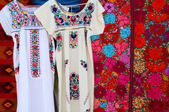 Chiapas Mayan dress embroidery and serape. Handcrafts from mexico royalty free stock photo