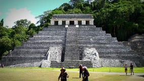 Tourists admiring Jaguar's Temple in the Palenque archeological zone. CHIAPAS, MEX-CIRCA AUGUST 2018: Tourists admiring Jaguar's Temple in the stock footage