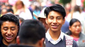 Native young men walking in the street. Chiapas, Mexico-Circa August 2018 (close up): Native young men walking in the street in San Cristobal de las Casas stock video footage
