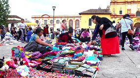 Merchant indigenous women offer clothes TAKE 1. CHIAPAS, MEXICO-CIRCA AUGUST 2018: Merchant indigenous women offer traditional clothes to the tourists in the stock footage