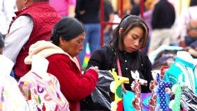 Merchant indigenous women offer clothes. Chiapas, Mexico - circa August 2018 (slow motion): Merchant indigenous women offer traditional clothes to the tourists stock video footage