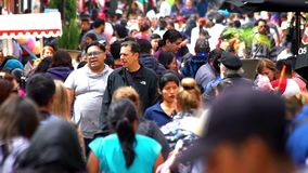 Tourists and local people walking in the street. CHIAPAS, MEXICO-CIRCA AUGUST 2018: Tourists and local people walking in the street in San Cristobal de las stock footage