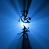 Chiarore dell'indicatore luminoso delle lettere di Kanji di Shinobi Immagine Stock