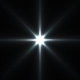 Chiarori della stella isolati sul nero Fotografia Stock Libera da Diritti