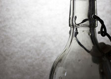 Chiaroscuro with glass bottle. On background Stock Image