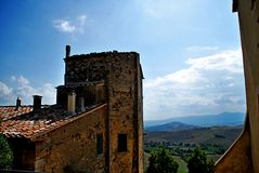 Chiasciano. Tuscany street city summer country road colors blue sky cloud Stock Image
