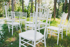 Chiavari chairs on grass Royalty Free Stock Photos