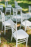 Chiavari chairs on grass Royalty Free Stock Image