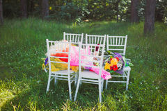 Chiavari chairs on grass with bouquet flowers. Chiavari chairs on grass. Beautifully arranged, prepared for the ceremony Royalty Free Stock Photography