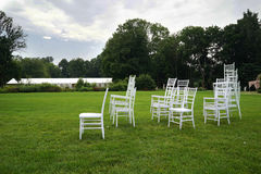 Chiavari chairs on grass. Royalty Free Stock Photography