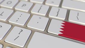 Chiave con la bandiera del Bahrain sui commutatori della tastiera da chiudere a chiave con la bandiera della Germania, della trad royalty illustrazione gratis