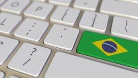 Chiave con la bandiera del Brasile sui commutatori della tastiera da chiudere a chiave con la bandiera della Germania, della trad royalty illustrazione gratis