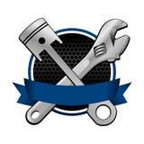Chiave del nastro blu ed emblema di corsa trasversale del pistone Fotografie Stock