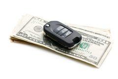 Chiave dell'automobile con i dollari Fotografie Stock
