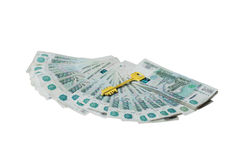Chiave dell'oro ai soldi Immagine Stock