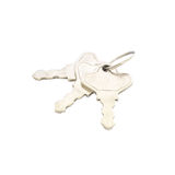 Chiave della casa del primo piano, chiave del metallo isolata su fondo bianco Fotografia Stock