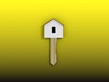 chiave domestica dorata 3D su fondo giallo Fotografia Stock Libera da Diritti