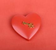 Chiave dorata con il cuore Immagine Stock Libera da Diritti