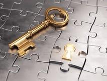 Chiave dorata e puzzle Fotografie Stock