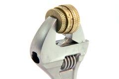 Chiave e monete Fotografie Stock